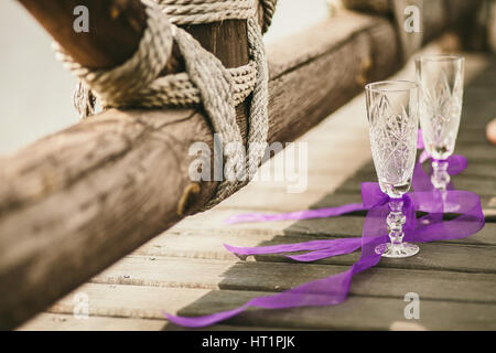 empty wineglass on wood background - Stock Photo