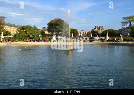 People at Tuileries Garden in Paris, France - Stock Photo