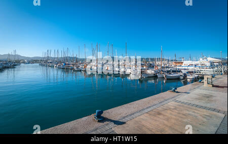 Boats, small yachts & water craft of all size in Ibiza marina harbour.  Warm sunny day. - Stock Photo