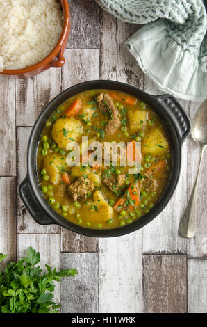 Spicy lamb and vegetable stew with basmati rice - Stock Photo