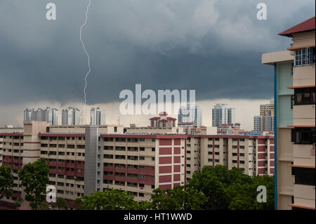 31.07.2016, Singapore, Republic of Singapore - A thunderstorm with thunder and lightning over the district of Ang - Stock Photo