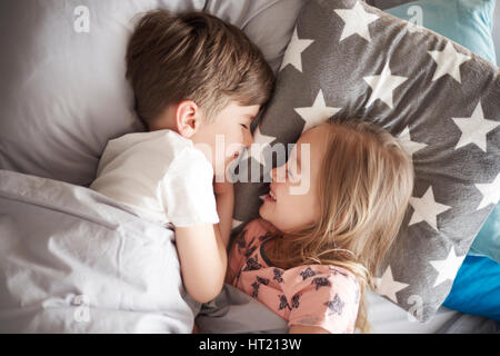 High angle view on sleeping siblings - Stock Photo