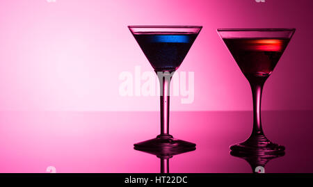 Colorful cocktails on reflective top - Stock Photo