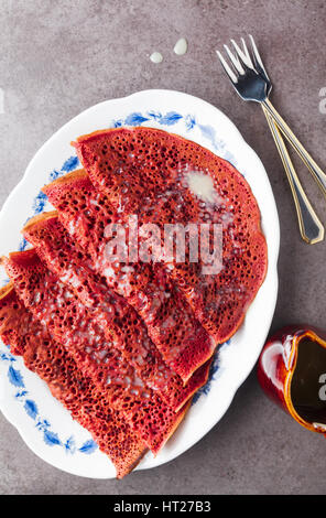 red velvet Pancakes with natural dye from Beetroot on a plate with Vanilla cream. healthy breakfast - Stock Photo
