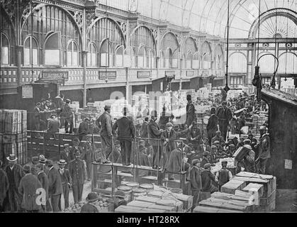 Fruit auctions at Covent Garden Market, London, c1901 (1901). Artist: Unknown. - Stock Photo