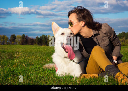 Young attractive girl with her pet german shepherd dog - Stock Photo