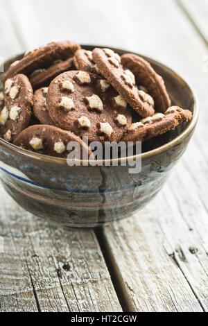 Dark chocolate cookies in bowl. - Stock Photo
