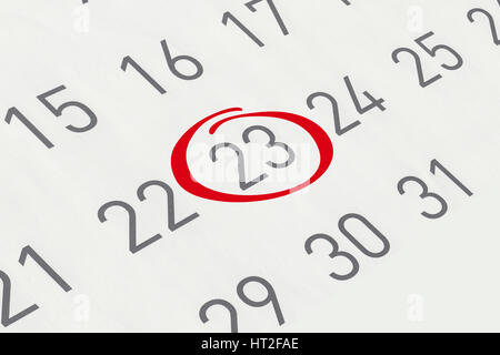 Mark the date number 23, focus point on the red marked number. - Stock Photo