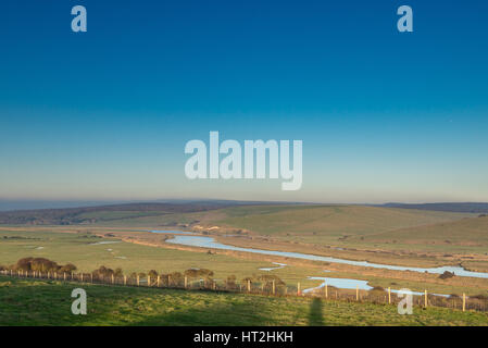 Across the Cuckmere Valley looking north towards Exceat from close to Seaford Head in Sussex, with late afternoon - Stock Photo