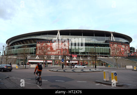 London, UK. 06th Mar, 2017. A cyclist passes the Emirates Stadium in London, England, 06 March 2017. Arsenal F.C. - Stock Photo