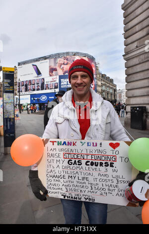 Piccadilly Circus, London, UK. 7th March 2017. Brian Wilson is trying to raise money to sit a gas course, that will - Stock Photo