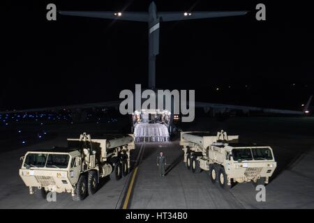 U.S. Air Force personnel unload THAAD missile defense systems from a C-7 transport aircraft at Osan Air Base March - Stock Photo