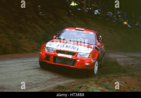 1999 Mitsubishi Lancer EVO, Network Q Rally.Timo Makinen. Artist: Unknown. - Stock Photo