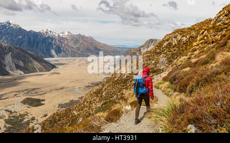 Hiker, View into the Hooker Valley from Sealy Tarns Track, Mount Cook National Park, Canterbury Region, South Island - Stock Photo