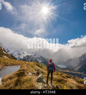 Hiker looking into Hooker Valley, mountain lake Sealy Tarns, Mount Cook National Park, Canterbury Region, Southland, - Stock Photo