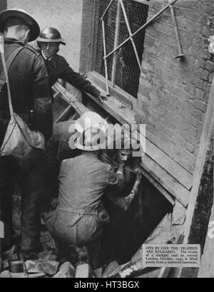 'One by one the trapped are released', 1940 (1942). Artist: Unknown. - Stock Photo