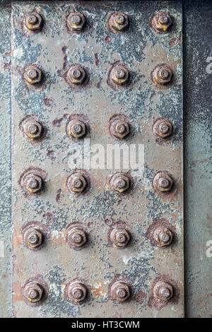 Bolted steel girder, nuts, rusty metal surface, structures, - Stock Photo