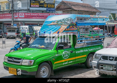 HUA HIN, THAILAND - SEPTEMBER 23, 2010: Songthaew pick-up truck in the center of Hua Hin. Songthaews are used as - Stock Photo