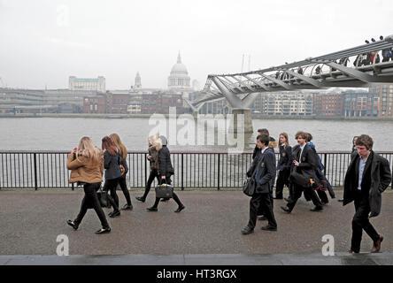 A group of students walking near the Millennium Bridge in London, UK  KATHY DEWITT - Stock Photo