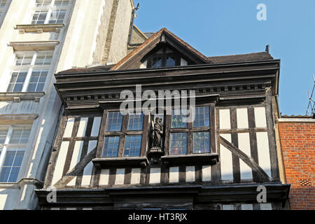 Detail of upper level and attic with sculpture of Gatehouse leading to St Bartholomew the Great Church West Smithfield - Stock Photo