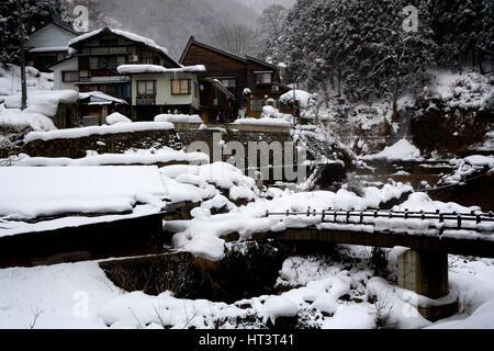 Japanese inn or ryokan, at Jigokudani National Park, Japan near hot springs favored by snow monkeys. - Stock Photo
