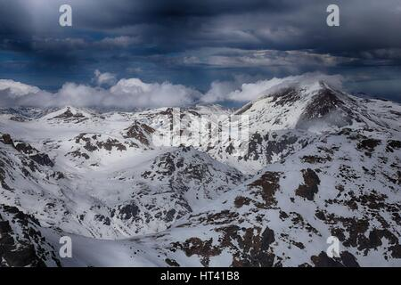 Sar / Sharr Mountains / Malet e Sharrit between Macedonia and Kosovo in winter seen from the highest peak of Kosovo - Stock Photo