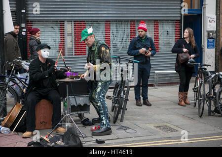 LONDON, UK - APRIL 22, 2016: LONDON, ENGLAND - JULY 12, 2016 Shoreditch, London: street musicians at Columbia Road - Stock Photo