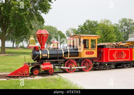 GREEN BAY WI - June 9, 2015:  Narrow gauge train engine at Bay Beach Amusement Park, a popular tourist attraction - Stock Photo