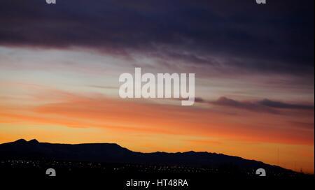 mountain sunrise on sandia mountains in new mexico - Stock Photo