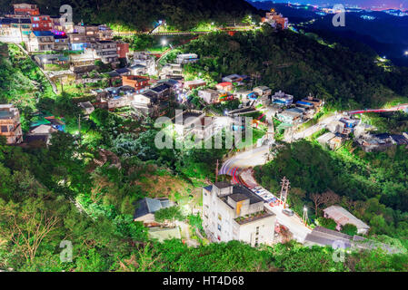 View of Jiufen town and nature at night - Stock Photo