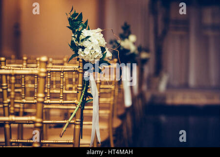 Floristic design on wedding ceremony day. Buch of flowers in wedding hall. - Stock Photo
