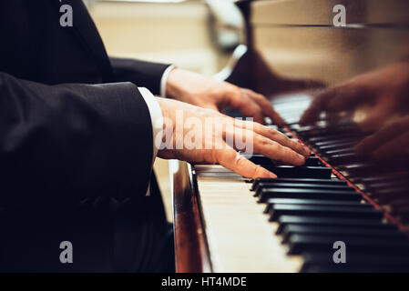 Playing classic piano. Professional musician pianist hands on piano keys. - Stock Photo