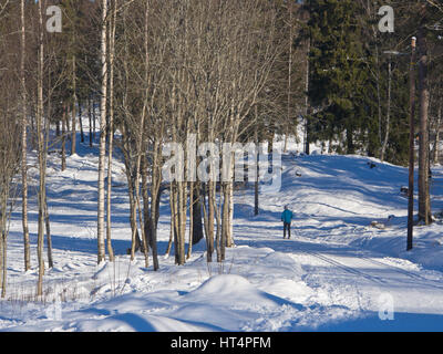 Sognsvann Oslo Norway, a sunny starting point for eager skiers and for a leisurely hike round the frozen lake, accessible - Stock Photo