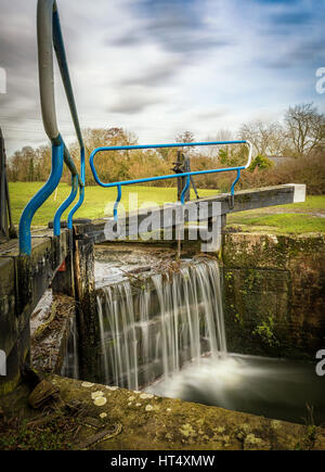 Water flowing through the lock gate system and waterfall at Beeleigh, nr Maldon, Essex - Stock Photo
