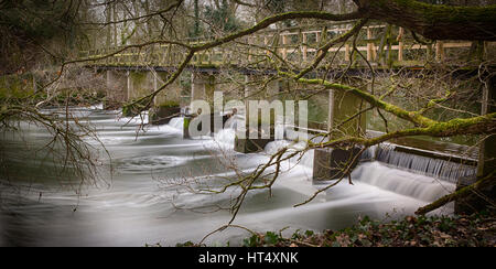 Water flowing through the waterfall at Beeleigh, nr Maldon, Essex - Stock Photo