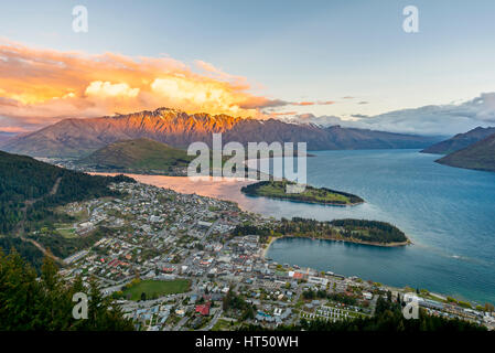 View of Lake Wakatipu and Queenstown at sunset, Ben Lomond Scenic Reserve, Berkgette The Remarkables, Otago, Southland - Stock Photo