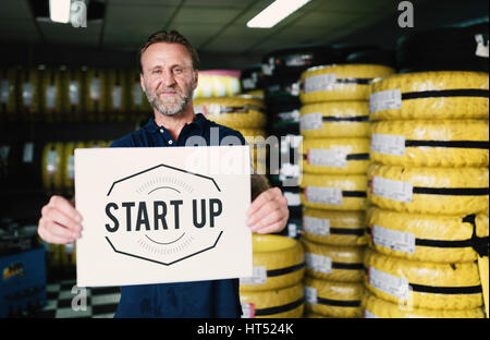 Car Parts Shop Owner Holding Placard Warehouse Startup Concept - Stock Photo