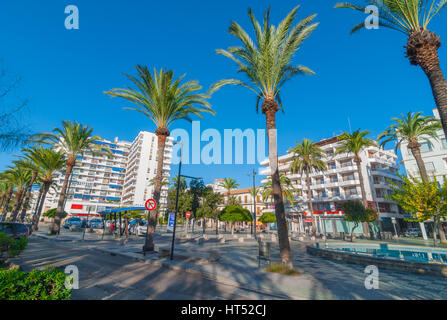 Sant Antoni De Portmany, Ibiza, November 6th, 2013:   Tourism in Spain.  People wait at a taxi stand.  Palm tree - Stock Photo