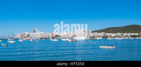 Boats in Ibiza marina harbour in the morning of a warm sunny day in St Antoni de Portmany, Balearic Islands, Spain. - Stock Photo
