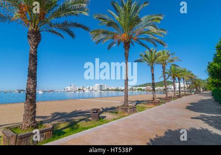 Ibiza sunshine on waterfront in Sant Antoni de Portmany,  Take a walk along main boardwalk, now a stone concourse, - Stock Photo