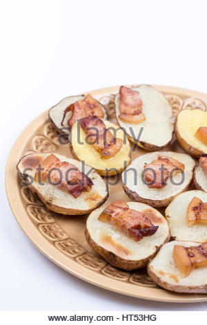 Fried bacon on baked potatoes with copy space. - Stock Photo