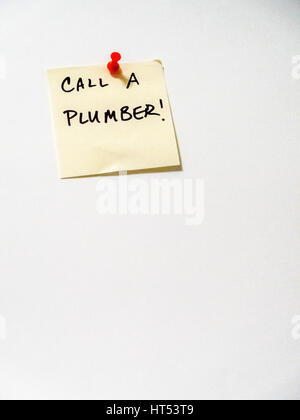 call a plumber post it note on white,  portrait orientation - Stock Photo