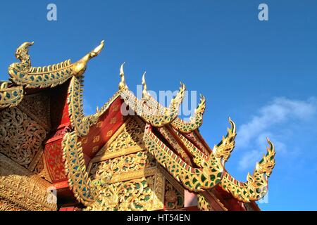 Details of northern style Thai temple roof against clear blue sky at Wat Phra That Doi Suthep, A famous Theravada - Stock Photo