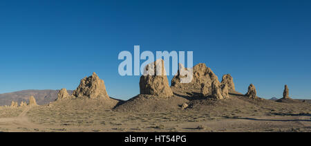Large pinnacles of rock form geological structures in the desert of California near Trona. - Stock Photo