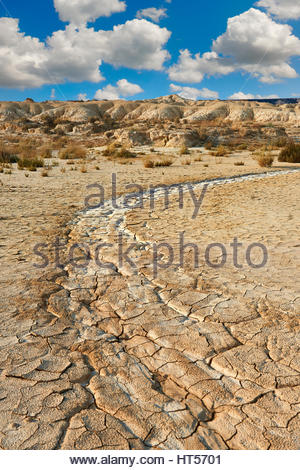 Rock formations and dried cracked mud in the Bardena Blanca area of the Bardenas Riales Natural Park, Navarre, Spain - Stock Photo