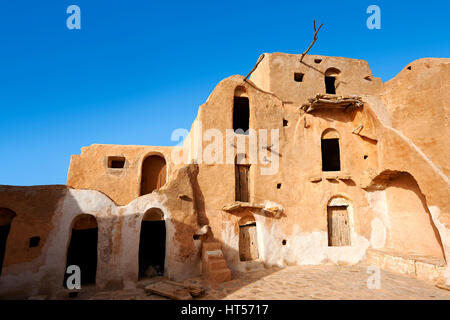 Ksar Ouled Soltane, a traditional Saharan Berber and Arab fortified adobe vaulted granary cellars, Tunisia - Stock Photo