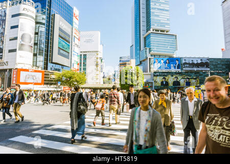 TOKYO - OCTOBER 24: Pedestrians at Shibuya crossing October 24, 2016 in Tokyo, JP. The famed crossing is one of - Stock Photo