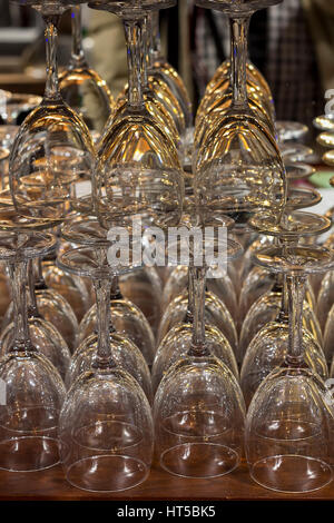 Empty glasses for wine sorted on a table in bar - Stock Photo