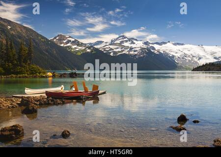 Distant Landscape View of Garibaldi Lake and Snowy Mountain Tops in Coast Mountains of British Columbia, Canada - Stock Photo