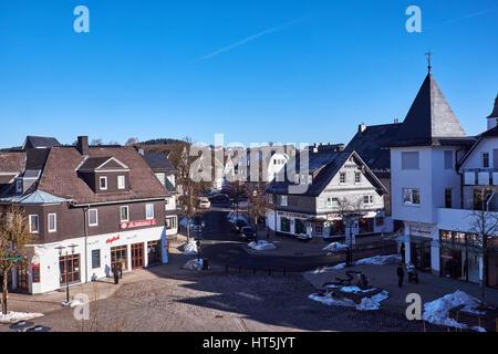 WINTERBERG, GERMANY - FEBRUARY 14, 2017: Small square at the center of the ski village Winterberg in Sauerland - Stock Photo